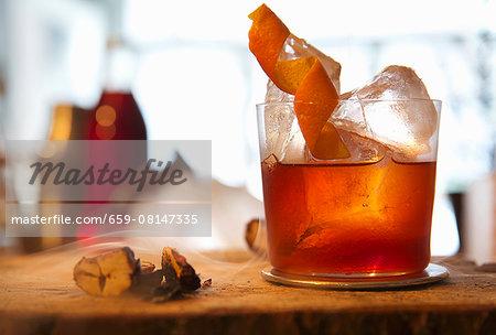 Negroni with orange zest and dry ice mist