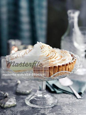 Lemon and lime meringue pie, sliced