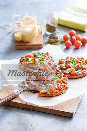 Mini pizzas with cherry tomatoes and mozzarella