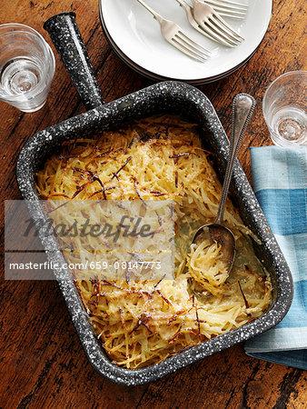 Grated potato gratin