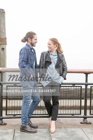 Couple on seafront, New York, New York, USA