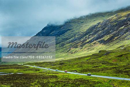 Traffic on Road through Scottish Highlands near Glencoe, Scotland, United Kingdom