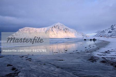 Skagsanden Beach with snow covered mountains (Hustinden 691m) in background, winter, Flakstad, Lofoten, Norway, Scandinavia.