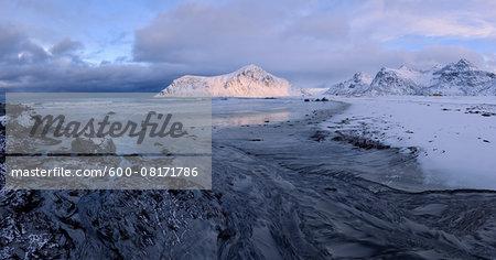 Skagsanden Beach with snow covered mountains (Hustinden 691m) in background, winter, Flakstad, Lofoten, Norway, Scandinavia