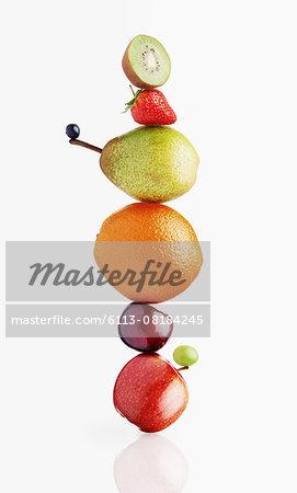 Stacked fruit on white background