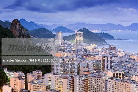 Twilight, illuminated view of Copacabana, the Morro de Sao Joao and the Atlantic coast of Rio, Rio de Janeiro, Brazil, South America