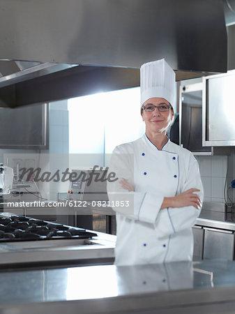 Proud Head Chef standing in his Restaurant