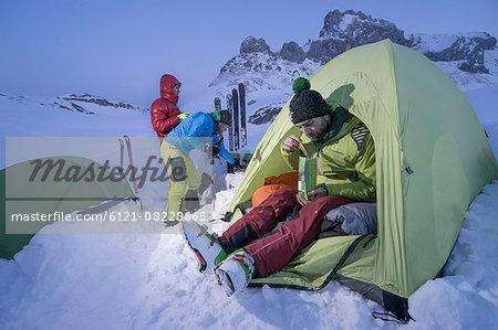 Men having dinner at bivouac camp, Tyrol, Austria