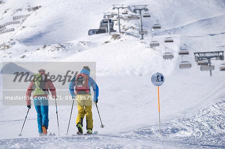 Tourists skiing on ski track, Zell Am See, Austria