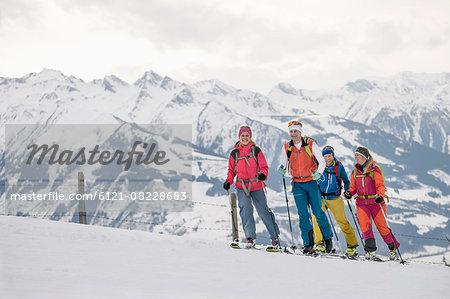 Ski mountaineers climbing on snowy mountain, Zell am See, Austria