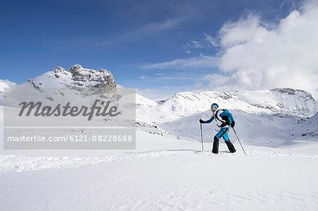 Ski mountaineer climbing on snowy mountain, Tyrol, Austria
