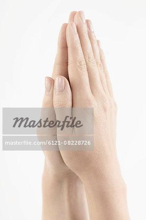 Close-up of woman hands together symbolizing prayer and gratitude, Bavaria, Germany