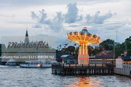 Tourists on carousel swings, Nordiska Museet, Grona Lund, Djurgarden, Stockholm, Sweden