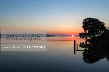 Sun shining over Chiemsee lake, Bavaria, Germany