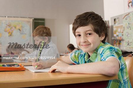 School students writing in notebooks, Munich, Bavaria, Germany