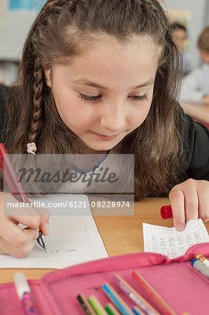 Schoolgirl cheating in examination, Munich, Bavaria, Germany