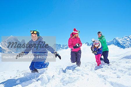 Family having snowball fight, Chamonix, France