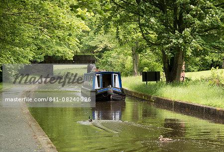 A narrow boat on the Llangollen Canal at Bryn Howel, Denbighshire, Wales, United Kingdom, Europe