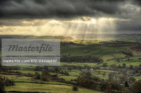 Sunbeams over Big Moor in the Peak District in Autumn.