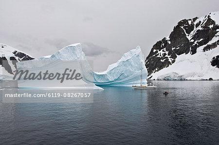 Sailing yacht and iceberg, Errera Channel, Antarctic Peninsula, Antarctica, Polar Regions