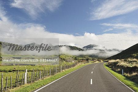 Road and farmland, near Matawai, Gisborne, North Island, New Zealand, Pacific