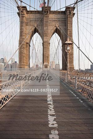 Early morning on Brooklyn Bridge, New York City, New York, United States of America, North America