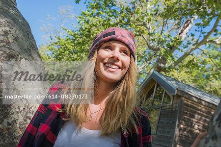 Woman standing by tree, El Capitan, California, USA