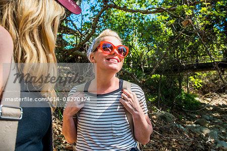 Women hiking in forest, El Capitan, California, USA