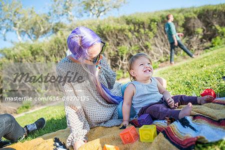 Mother and baby at picnic, El Capitan, California, USA
