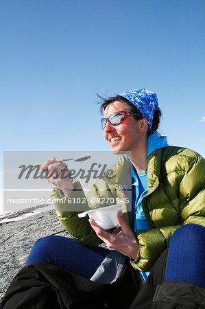 Smiling skier eating