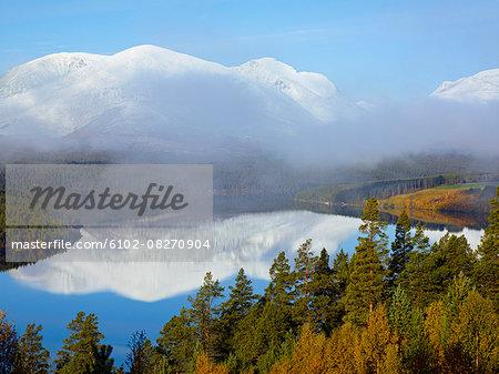 Mountains reflecting in lake