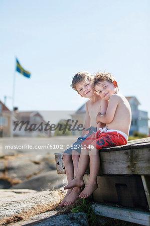 Boys sitting  together