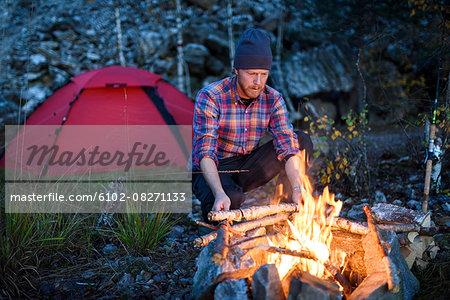 Man having campfire