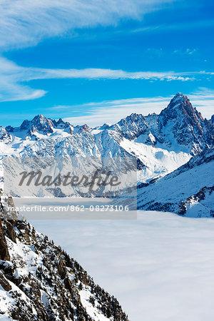 Europe, France, Haute Savoie, Rhone Alps, Chamonix, sea of clouds weather inversion over Chamonix valley, Aiguille du Chardonnet (3824m)