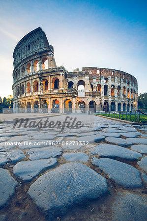 Rome, Lazio, Italy. Colosseum and Via Sacra at sunrise
