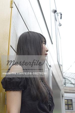 Young Harajuku woman looking up