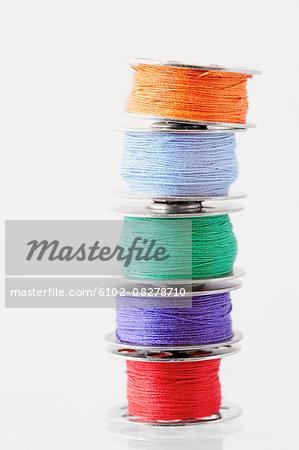 Stacks of spools of multicolor thread
