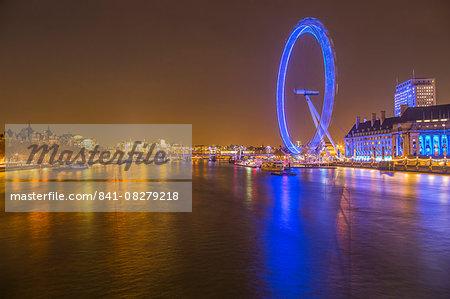 London Eye illuminated at night, and the River Thames, London, England, United Kingdom, Europe