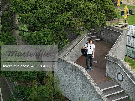 Young man walking on staircase, Melbourne, Victoria, Australia