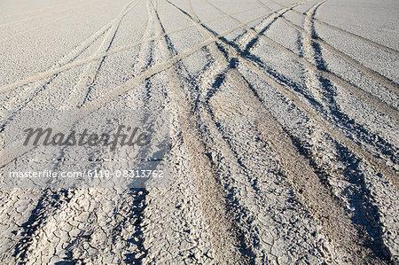 Tire tracks on the playa, salt flats surface.