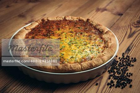 Homestyle pie crust in rustic setting black pepper