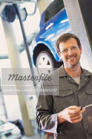 Portrait confident mechanic in auto repair shop