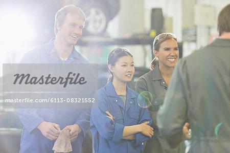 Mechanics listening in auto repair shop