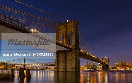 Night view of Manhattan and Brooklyn bridges, New York, USA