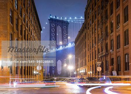 Manhattan Bridge and city apartments at night, New York, USA