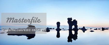 Rock formations reflecting at sea