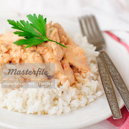 Creamy Tomato Chicken on Rice, close up