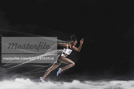 Athlete running in the smoke