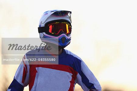 Motocross biker on dirt track
