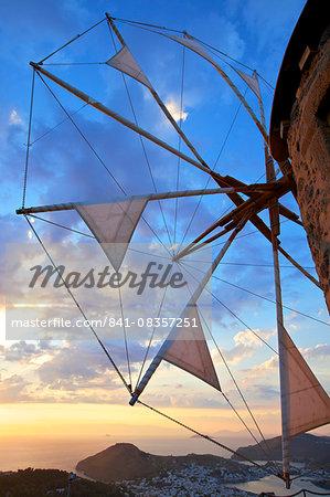 Windmills of Chora overlooking Skala at sunset, Patmos, Dodecanese, Greek Islands, Greece, Europe